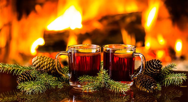 holiday drinks in front of a fire