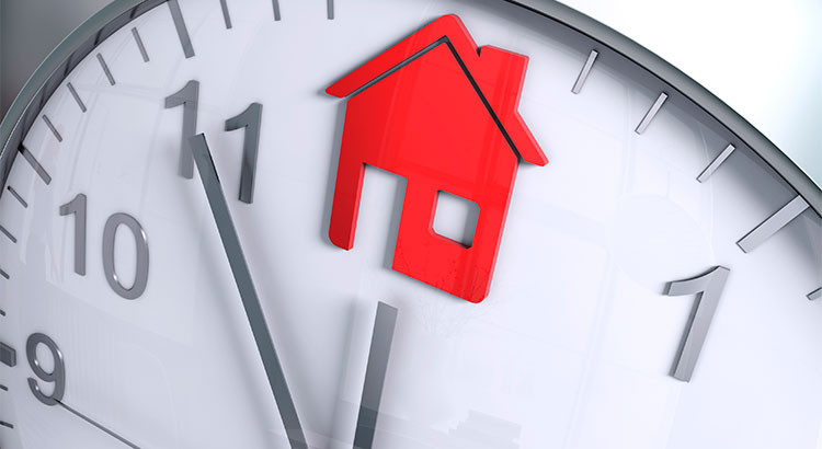 Clock with hour hand on an image of a house