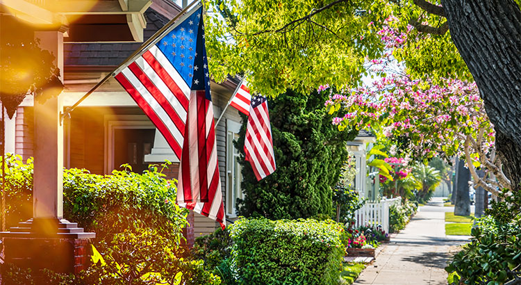 American flags hanging in front of houses