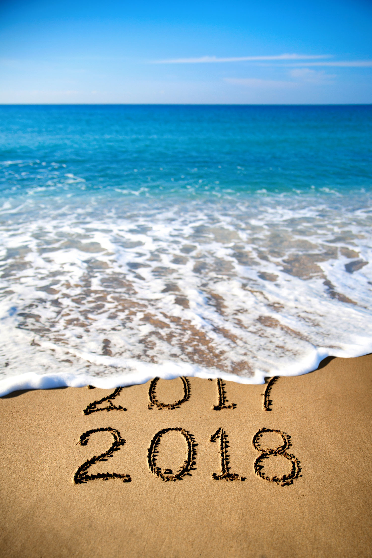 beach with 2018 in the sand