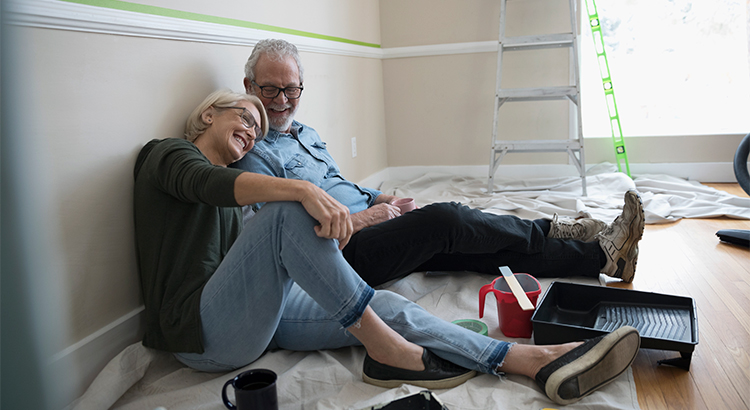 older couple laughing and sitting on the floor