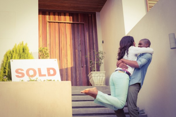 man hugging a woman and lifting her up because they sold their home