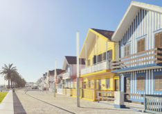 Row of colourful beach houses in Costa Nova, Portugal